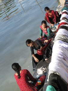 Dhobis by a river in Udaipur